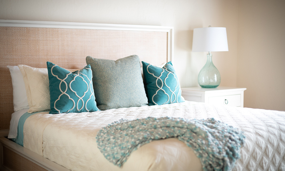 White bedroom with blue aqua coloured pillows looks refreshing, aqua color best paint.