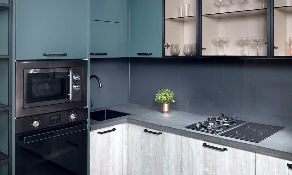 Kitchen cabinets in aqua blue paint colour finish look bright and cheerful.