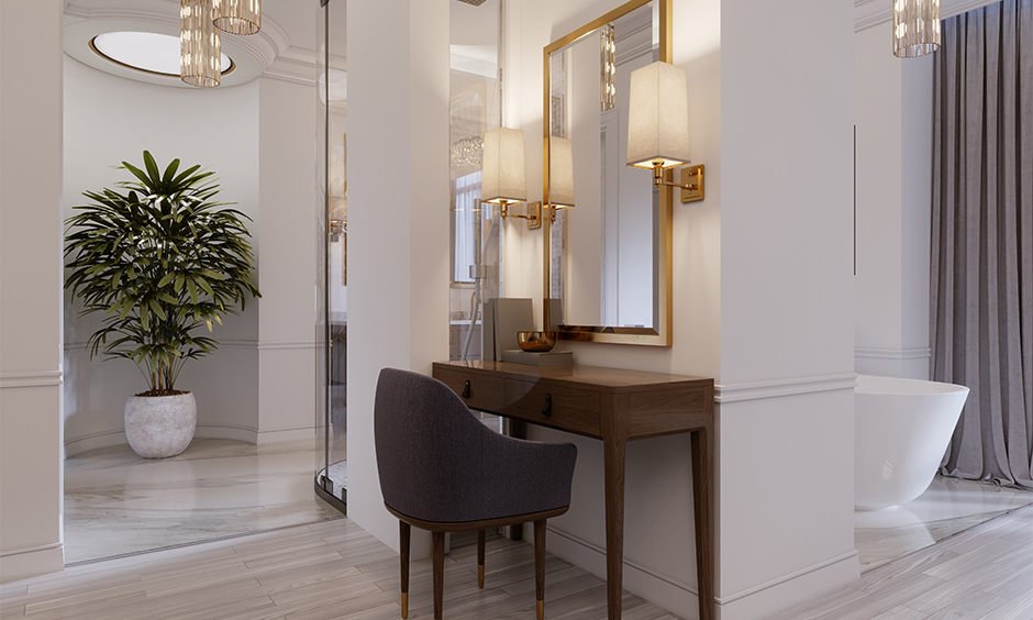 An old-school dressing table with wall lamps beside the gold-framed mirror looks classic, dressing table light design.
