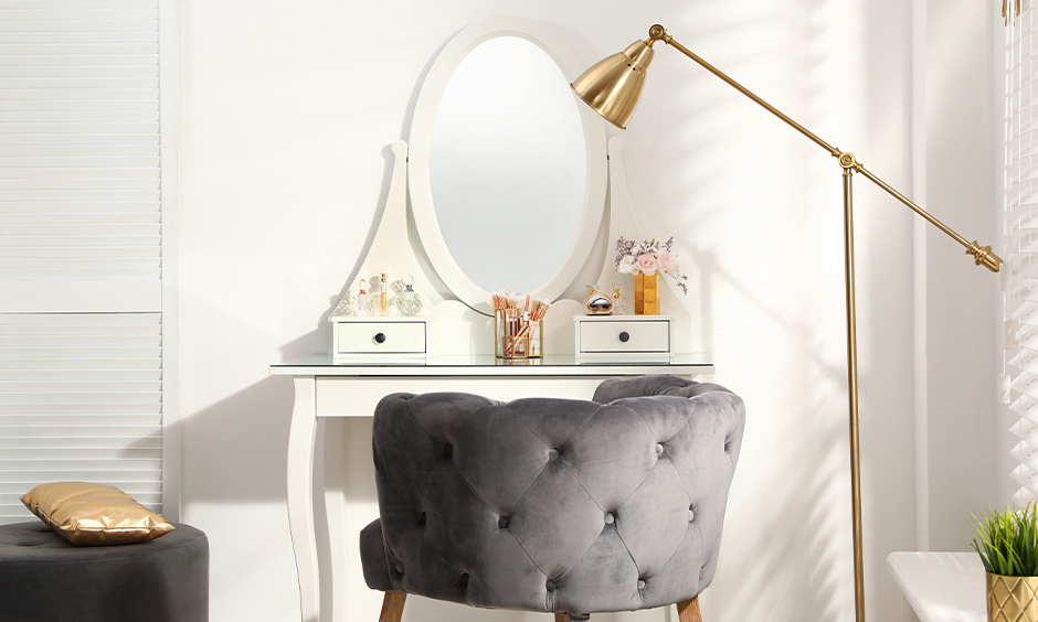 White dressing table with a portable and adjustable lamp look sleek, dressing table light idea.