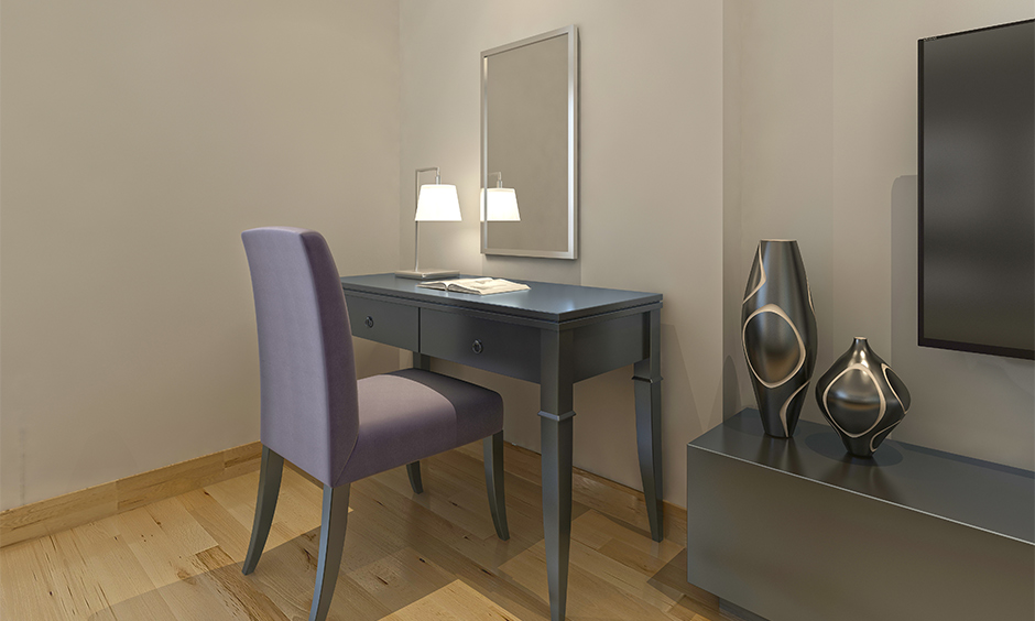 Dressing table light, dressing-cum-reading table with a table lamp in a minimalistic look in the bedroom.