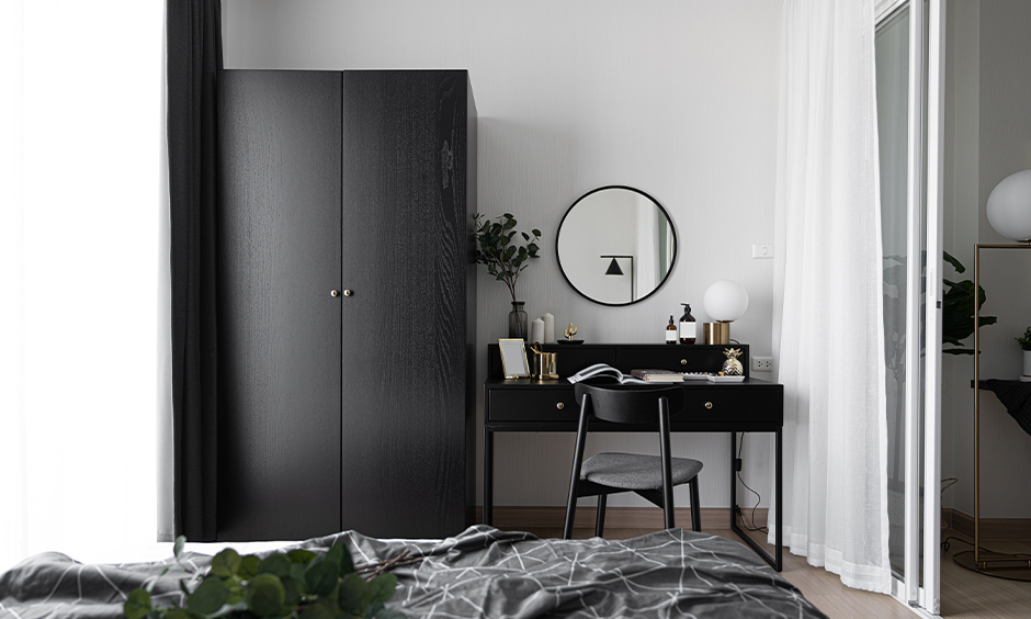 All-black colour dressing table with a chair in the bedroom looks elegant.