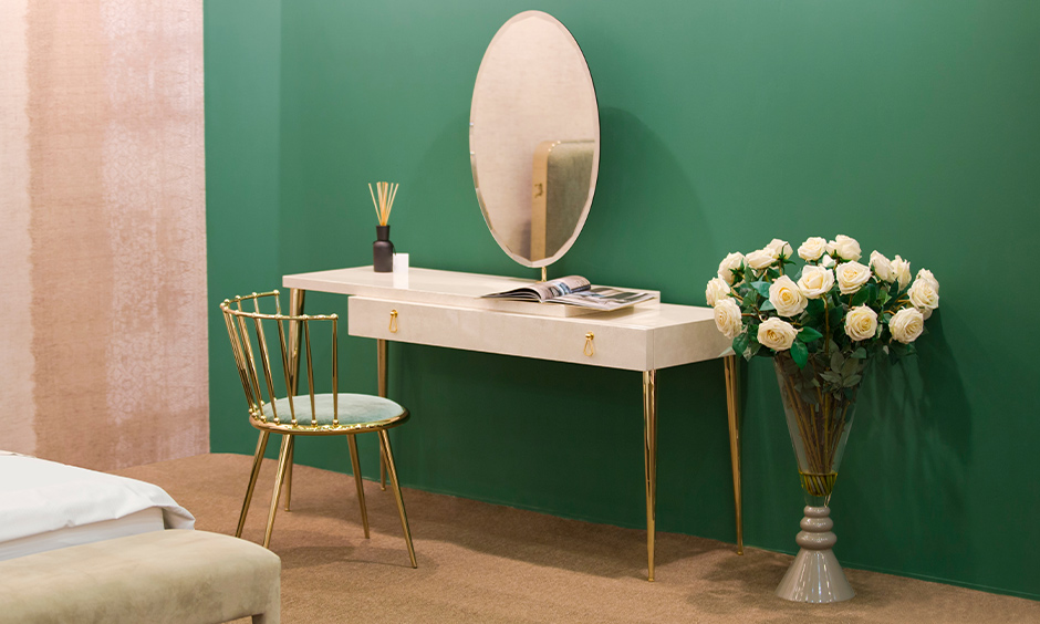 Gorgeous marble-white dressing table colour with golden legs spells luxury.