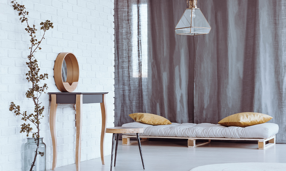 Minimal petite grey colour dressing table and stool in the bedroom look modern.