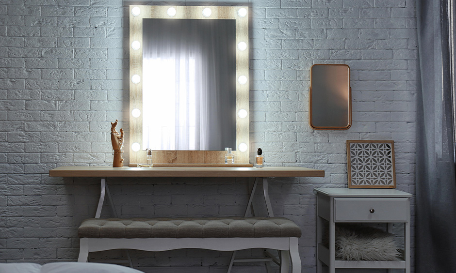 Dressing table colour combination in grey and wood with seating bench look elegant.