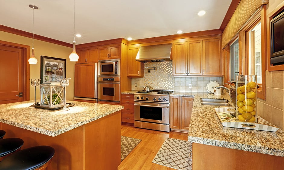 Warm kitchen granite countertops colors with a yellowish