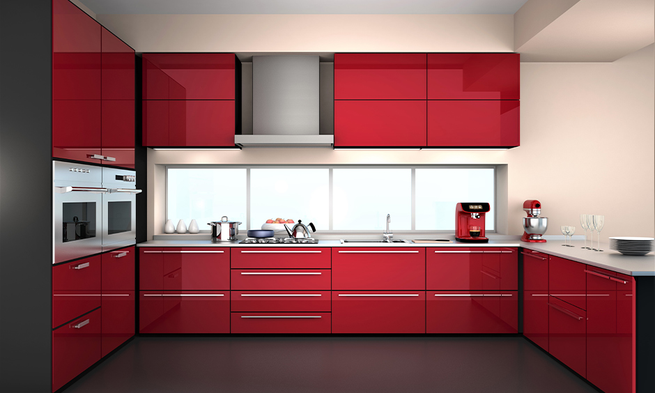 Kitchen cupboard designed and coloured in ruby red makes a very bold statement