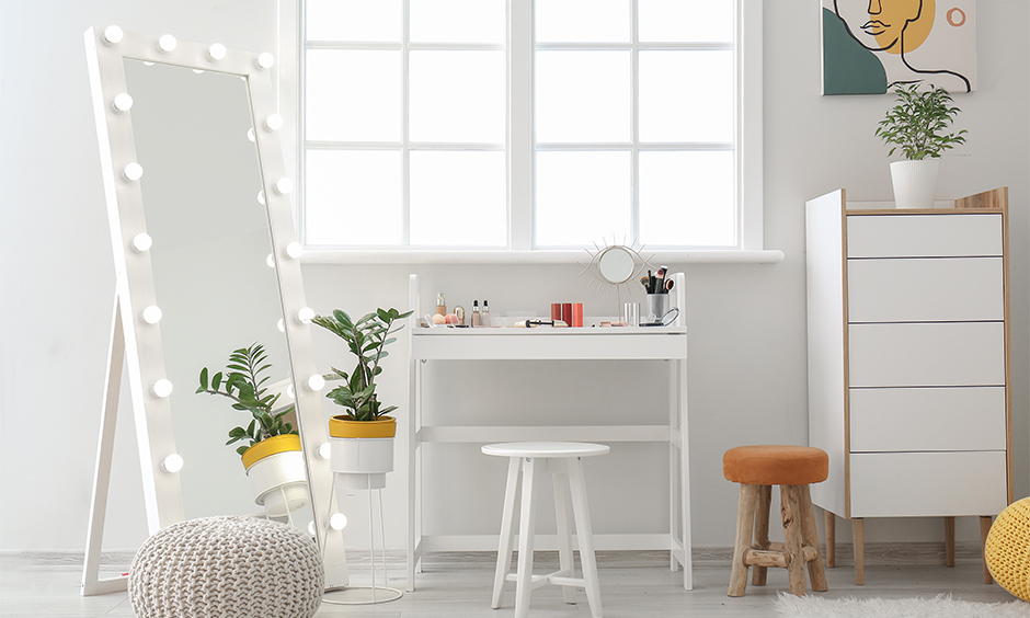 Portable white dressing unit and full-length mirror with a sleek look are a dressing table idea for small bedroom