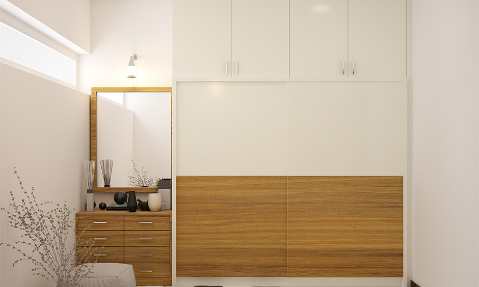 Dressing unit with mirror and drawers at a corner in the bedroom attached to the wardrobe, dressing table for small spaces