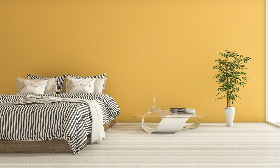 Yellow walls with sheer white curtains give your room a rich and luxurious