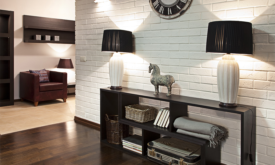 All white small hallway paint ideas with vintage wall clock and elegant table lamps