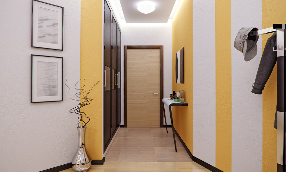 Natural yellow hallway paint ideas with white stripes which adds a fun element to home