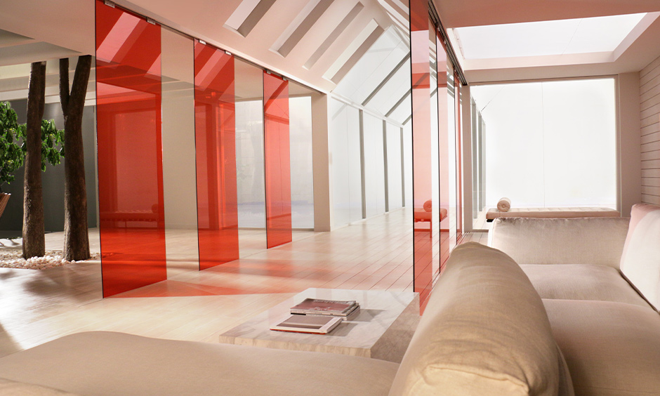 Modern touch red coloured type of glass partition walls enhances the look of the area.
