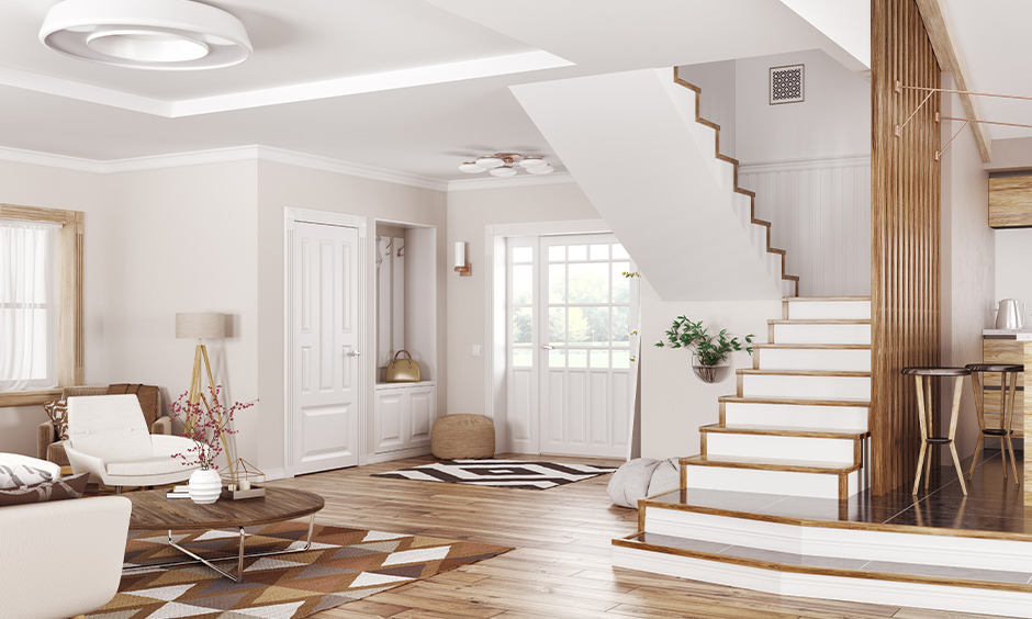 Staircase wall decor, This white staircase wall with wooden bars creates elegant stairway entry