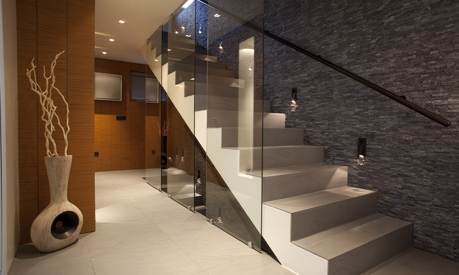 Staircase wall stairway decorating idea, a textured wall with built-in wall lights creates a dreamy pathway