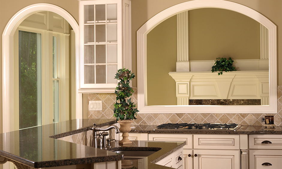 Double door kitchen arch designs inside home creating an inviting ambience
