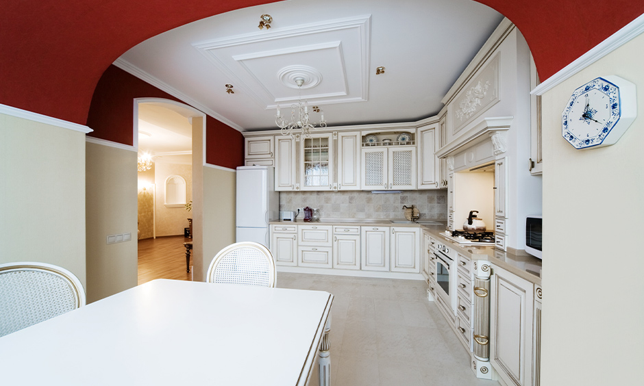 Creative modern arch design for kitchen with lustrous oxblood and glossy cream paint