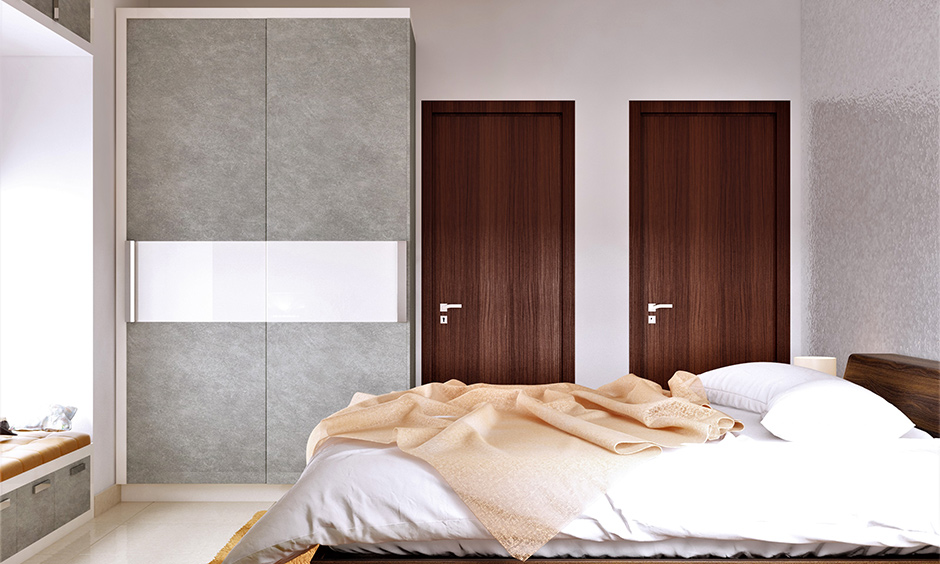 Godrej almirah colour shades in grey and white combination in the bedroom look sleek.