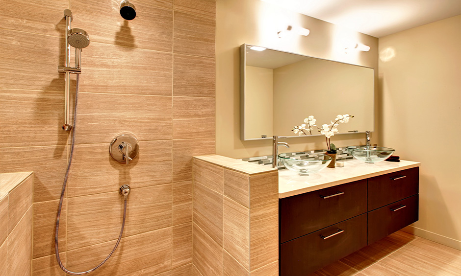Beige and brown bathroom wall mirror with led lights above it look clean and sleek.