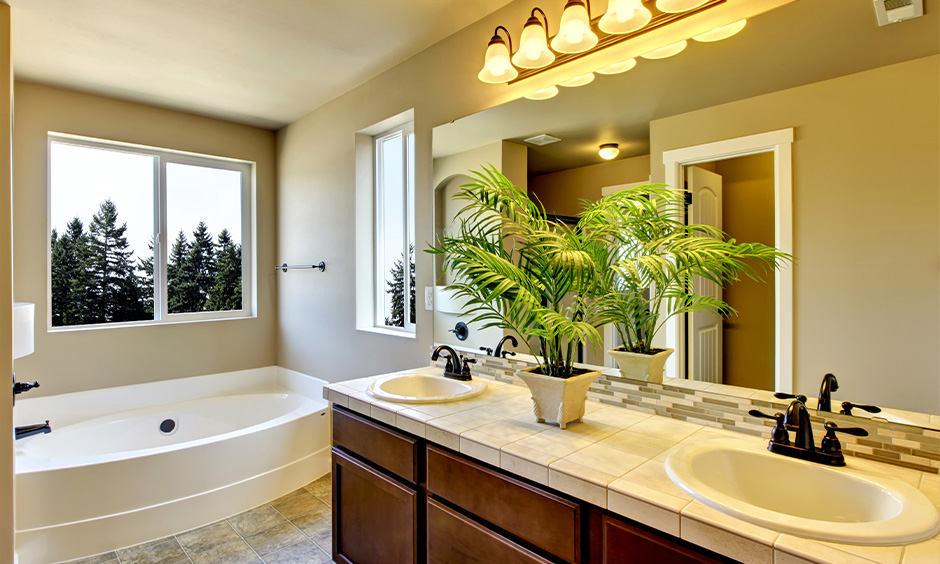 Antique bathroom wall light, neutral-coloured bathroom with bell-framed downlights brings royal touch.