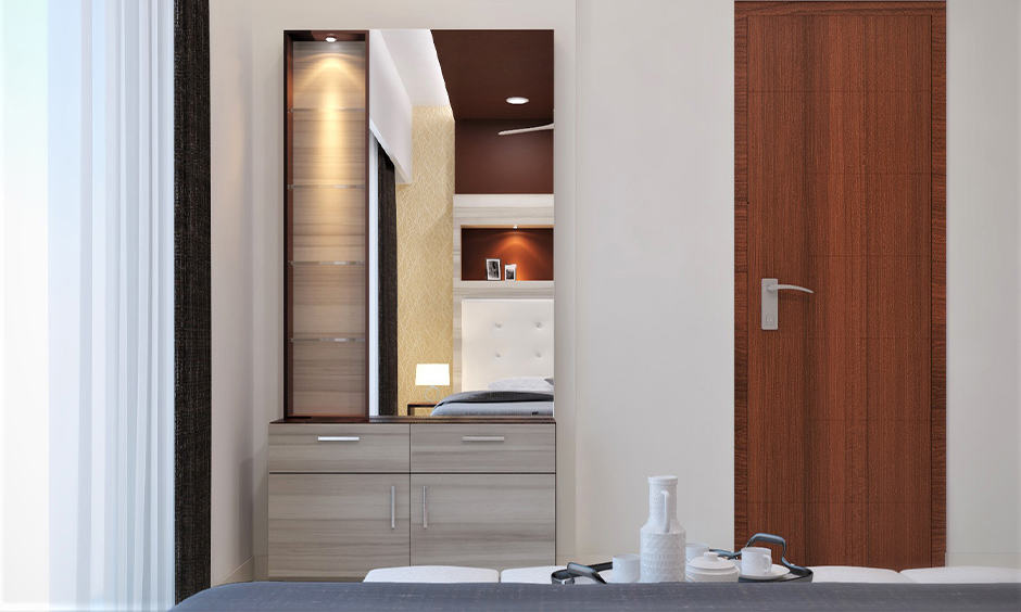 Simple dressing table designs with multiple shelves brings  classy vibe  into the bedroom