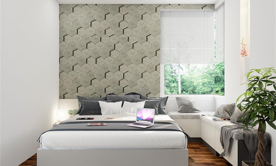 Bedroom window design, white bedroom with an angular glass window looks modern.
