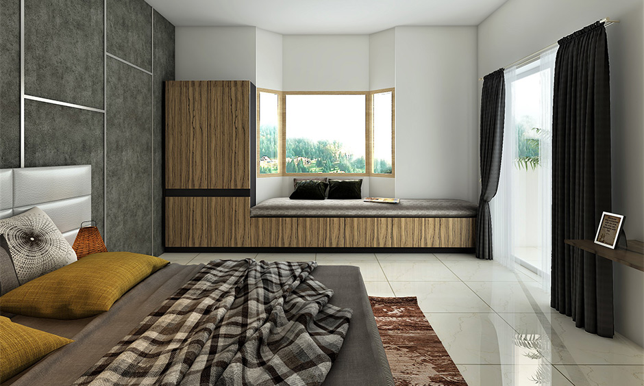 Bedroom window glass design with two angled side windows and cosy seating area brings calmness.