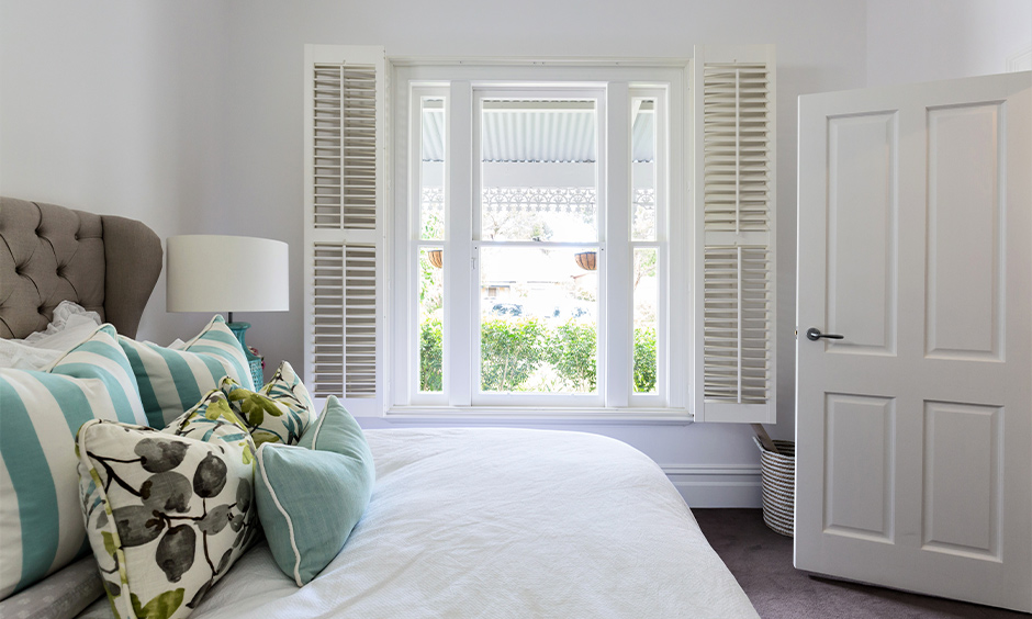 Bi-fold shutter small bedroom window design gives a very traditional yet luxurious look.
