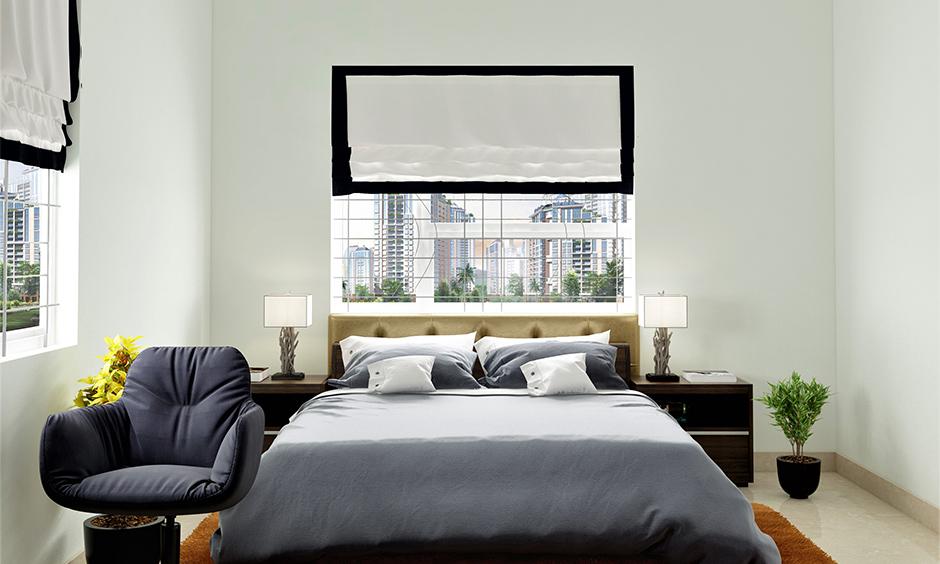 Single-hung bedroom window grill design with sashes behind bed headboard look minimalist.