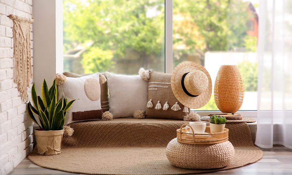 Floor seating idea for the bedroom, straw cushions and a rug arranged near the window creates a harmonious look.