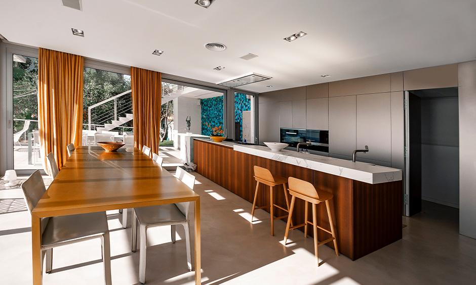 East as per Vastu best direction for kitchen cum dining area design for luxury.