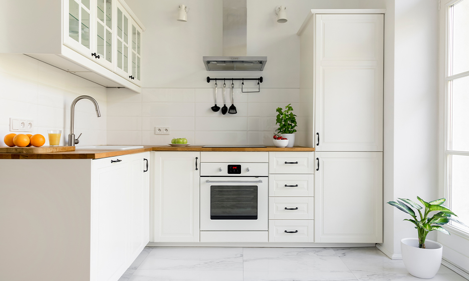 White kitchen in east direction as per Vastu with the window facing for sunlight brings a positive vibe.
