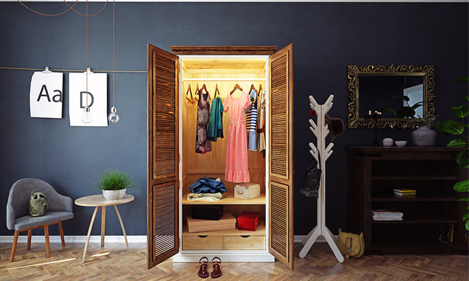 Open solid wood two-door wardrobe inside design with a clothes hanger rod and set of drawers in the bedroom.
