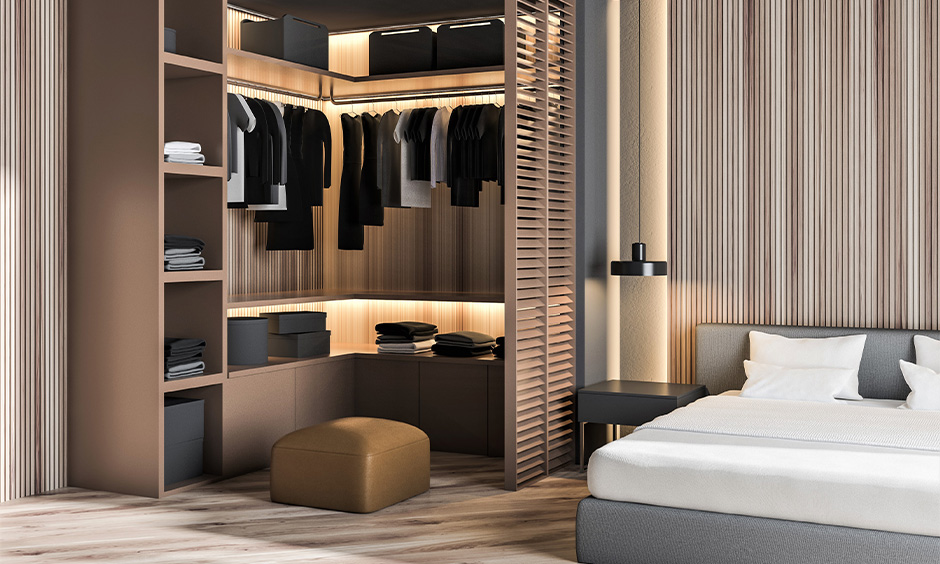 Corner wooden wardrobe inside design with rod hanger, shelves, baskets and boxes with backlighting look luxurious.