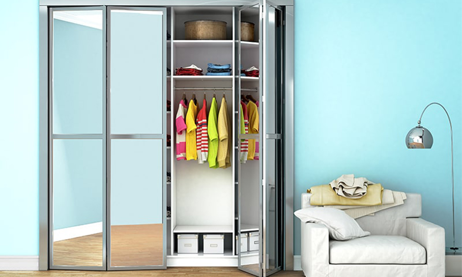 Wardrobe inside design idea, bi-folding door wardrobe with mirror outside design with shelves and a hanging rod.