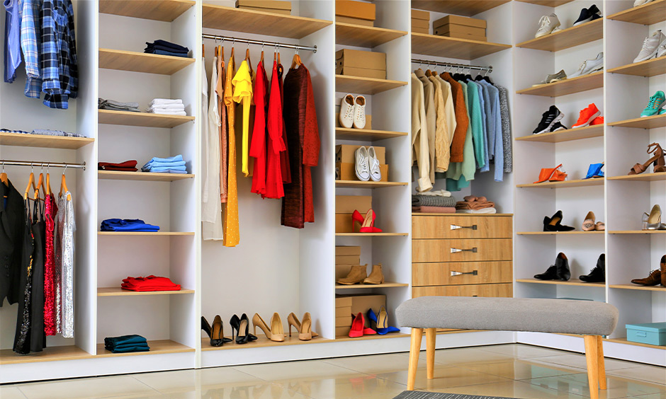 Modern wardrobe design inside, open-shelving wardrobe designed with drawers, rod hanger and shelves looks minimal.