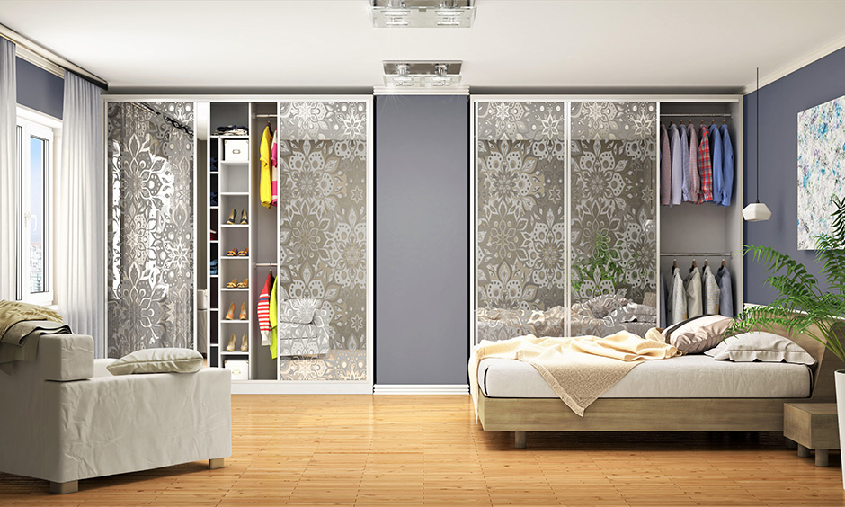 A sliding wardrobe design inside, Two wardrobes with two-rod hanging section, multiple shelves and compartments.