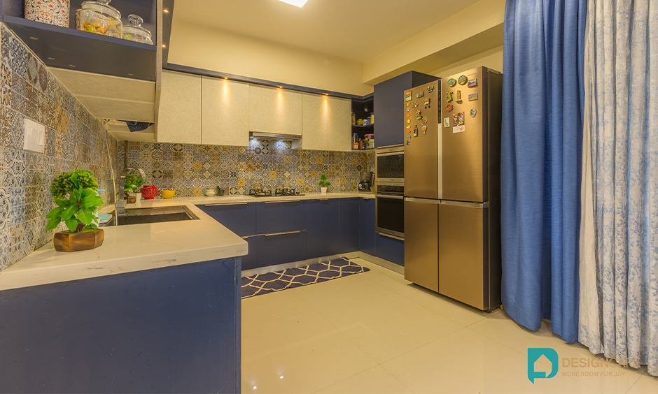 2bhk u shaped kitchen interior design with cabinets in blue and white laminate in Bengaluru look stunning.