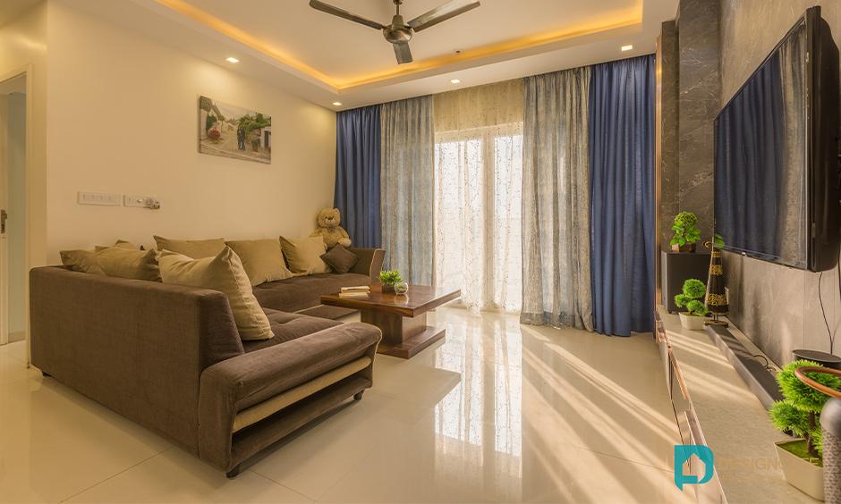 Living room design in 2bhk in bhoganhalli bengaluru with tv unit and wooden panelling look elegant.