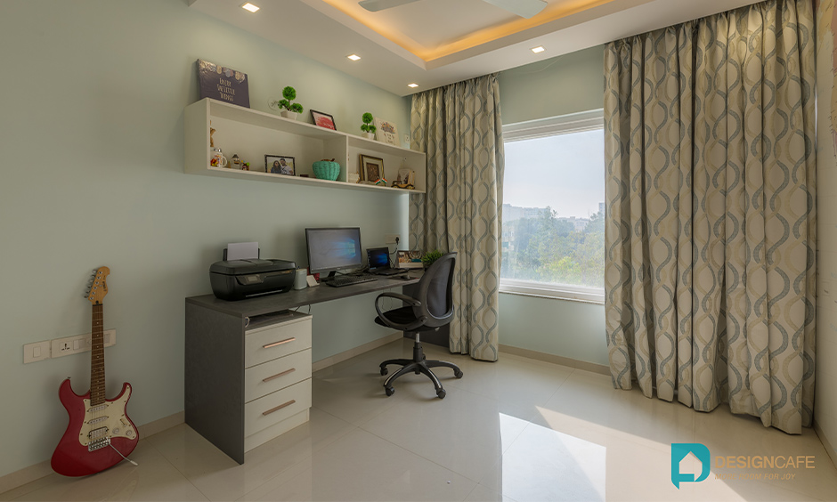 Minimalist light green study room with sophisticated table design is a simple interior design for 2bhk flat in Bengaluru Bhoganhalli.
