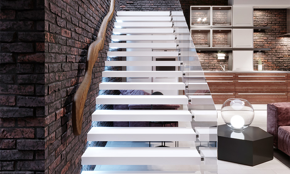Open well staircase designed with wood and glass lends a clean, crisp and minimalistic ambience to space.
