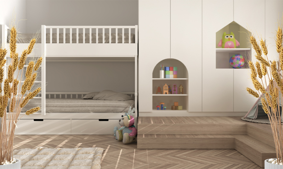 Bunk bed design in white colour for children adds a fun quotient to the bedroom.