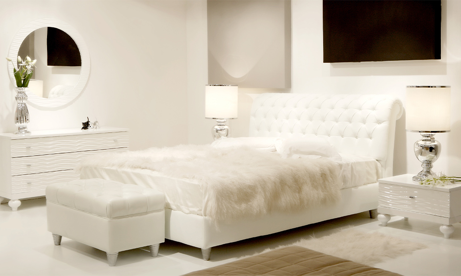 White colour bed design with softest bed sheets and warm furry in the all-white bedroom look chic and gorgeous.