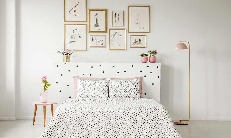 Polka dots white colour bed design with pillows in the white-themed bedroom.