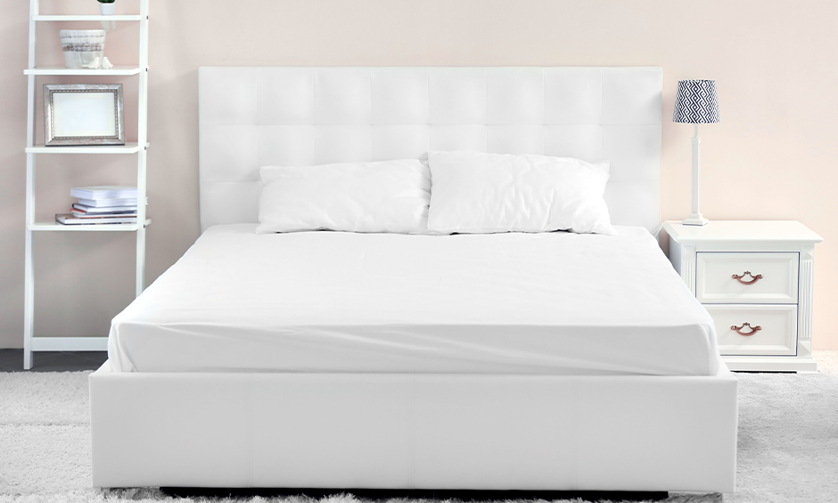 Minimal white colour double bed focuses more on the functional aspect of the room.