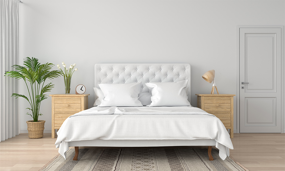 White colour bed paired with a natural element gives a clean and serene look to the bedroom.