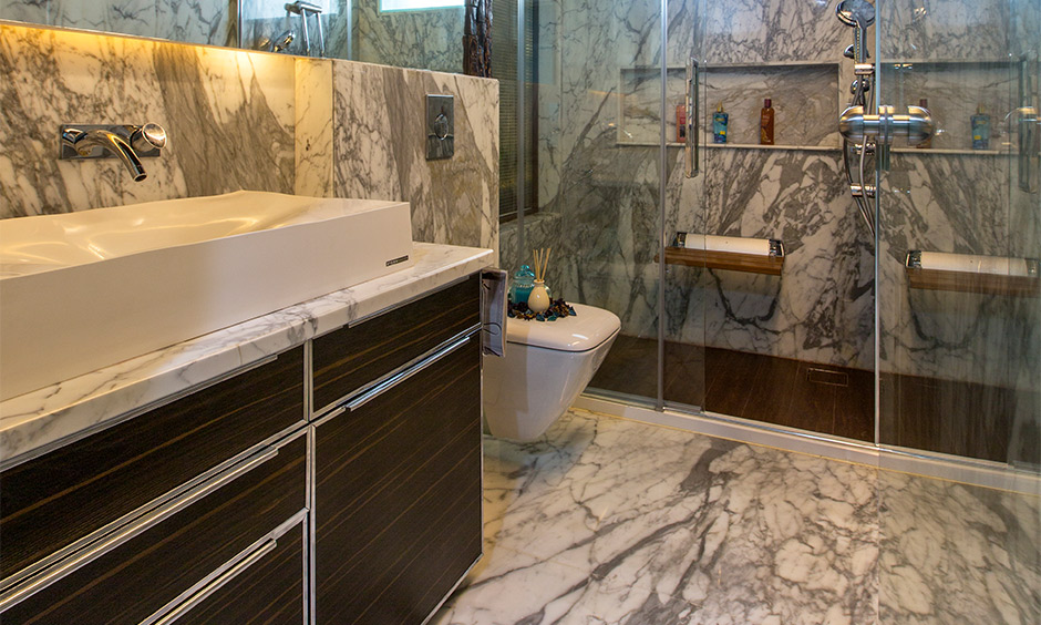 Independent house interior design, bathroom designed with wooden cabinet and marble flooring look classy.