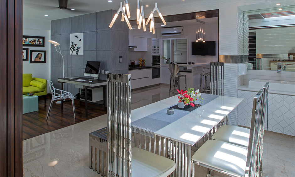 Dining room with a table and chairs made from stainless steel and white wood, independent house interior design.