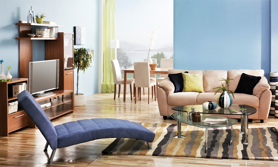 Home furniture design for hall, Blue recliner and double glass centre table furniture is an absolute masterpiece.