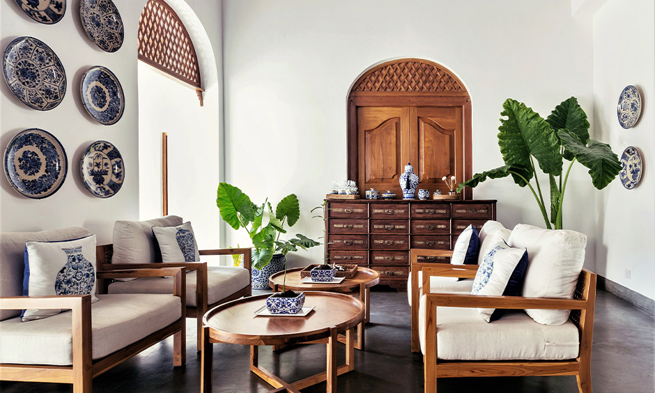 Portuguese style simple hall furniture design with sofa set and two centre table is gorgeous.
